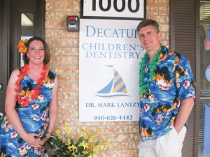 OPEN HOUSE - The Bridgeport area Chamber of Commerce held a ribbon cutting for Decatur Children's Dentistry June 6. Pictured are Dr. Mark Lantzy (night) and Keltie Lantzy.