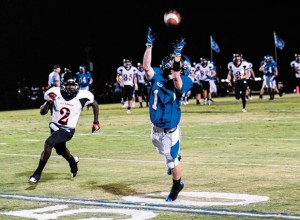REACHING OUT - Decatur's Cain Lowe makes a leaping grab against Burkburnett. Messenger photo by Joe Duty