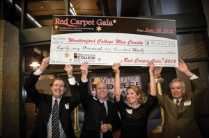 SCHOLARSHIP MONEY - Associate Dean Matt Joiner (from left), Vice President of Institutional Advancement and Executive Director of the Weatherford College Foundation Brent Baker, Event Chair Marianne Henderson and Dean Duane Durrett hold a check representing the donations made at Saturday night's Red Carpet Gala.
