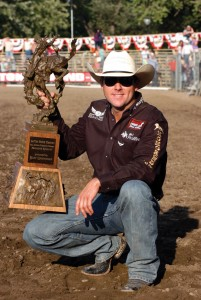 SOLID FINISH - The ever-consistent Trevor Brazile clutches the all-around trophy after winning in Pendleton. Photo courtesy of East Oregonian