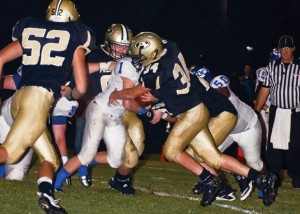TAKE DOWN - Alvord's Shane McKinney makes the tackle against Gunter Friday. Messenger photo by Mack Thweatt