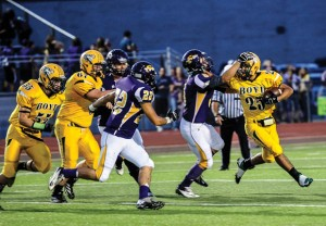 TO THE EDGE - Boyd's Fino Cardona gets around the Sanger defense during the Yellowjackets' win last Friday. Messenger photo by Joe Duty