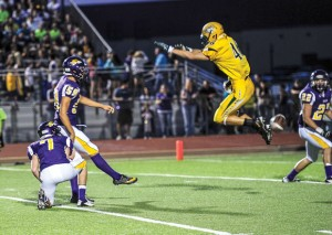 UP AND AWAY - Decatur's Chase Graham gets some air while attempting to block a sanger kick. Messenger photo by Joe Duty
