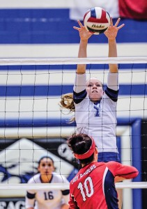 UP-AND-OVER -Decatur's Darci Billmore goes up for a block Tuesday against Denton Ryan. Messenger photo by Joe Duty