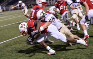 A LITTLE MORE - Northwest's Emmanuel Moore leans for extra yardage against Keller. Messenger photo by Joe Duty