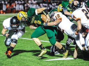 CHURNING AHEAD - Boyd's Blake McDonald fights through Pilot Point defenders Friday. Messenger photo by Joe Duty
