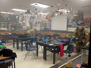 CLEARING THE WAY - Decatur firefighters check a classroom Friday at McCarroll Middle School. Messenger photo by Joe Duty