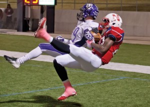 FALLING INTO PLACE - Northwest&#039;s Emmanuel Moore catches a pass from Draze Lawliss and falls backward into the Texans&#039; endzone for a touchdown. Messenger photo by Jimmy Alford
