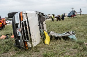 FRIDAY WRECK - Lindsay Adams, 29, of Rhome was flown to John Peter Smith Hospital in Fort Worth after she flipped her truck multiple times. Her injuries were not life-threatening. Messenger photo by Joe Duty