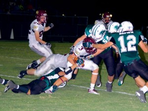 GANGING UP - Paradise's Jordan Carter and Hayden Brown make the stop against Whitesboro. Messenger photo by Mack Thweatt