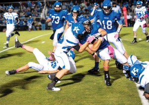 HAD HIT - Decatur's Jared Durdon is brought down on a punt return. Messenger photo by Joe Duty