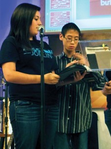 INTERPRETING - Courtney Cantu translates to the youth group a scripture Zachary Kao memorized. Messenger photo by Paris Walther