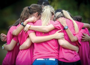 LAST WORD - The Decatur Lady Eagles huddle one last time before the start of the race. Messenger photo by Joe Duty