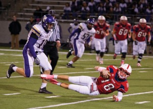 LAYING DOWN - Northwest's Draze Lawliss gets pushed down as he tries to run up the field. Messenger photo by Jimmy Alford