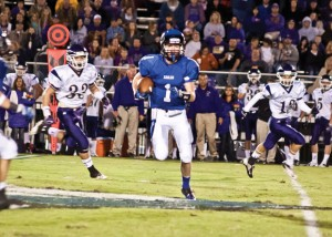 NICE CATCH - Decatur's Cain Lowe looks for running room after making a reception against Alvarado. The Eagles open district play at Gainesville Friday. Messenger photo by Jimmy Alford