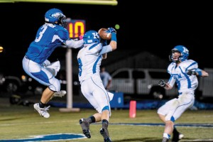 NICE CATCH - Krum's Angel Martinez Hauls in a touchdown pass against Ben Blattner. Messenger photo by Joe Duty