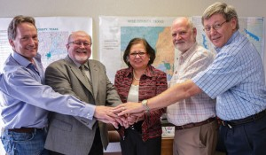 ON THE SAME TEAM - Wise County election officials greeted Texas Secretary of State Hope Andrade Tuesday. Shown are (from left) Democratic Party Chairman Mark York, County Judge Bill McElhaney, Andrade, Electiona Administrator Lannie Noble and Tax Assessor-Collector Monte Shaw. Messenger photo by Joe Duty