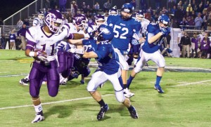 OUT OF REACH - Decatur's Austin Givens lunges to make the tackle against Alvarado's Marcus McNeil. Messenger photo by Jimmy Alford