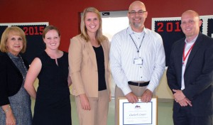 OUTSTANDING TEACHER - Northwest High School government teacher Charles Cooper (second from right) was presented a plaque and $5,000 cash award for receiving the 2012 Outstanding Teaching of Humanities Award. Pictured (left to right) are Joy Ann Havran, Humanities Texas board member; Liz James, coordinator of educational programs at Humanities Texas; Chandler Cochran, field representative for Sen. Jane Nelson; Cooper; and Jason Childress, NHS principal. Submitted photo