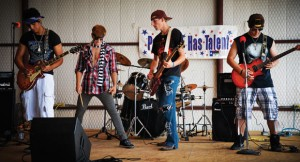 "PARADISE HAS TALENT - Members of Duck Dive, Paradise High School seniors Elijah Strand, Brandon Lopez, Damian Silvas and Wesley Meadows were the opening act in the Paradise Has Talent talent show at Paradise Main Street Festival Sept. 29. They performed ""Afterlife"" by Avenged Sevenfold. Messenger photo by Joe Duty"