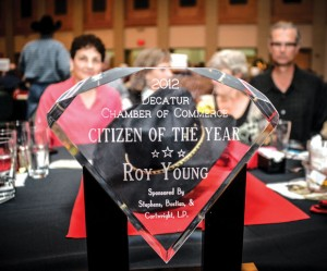 POSTHUMOUS PRESENTATION - Roy Young&#039;s familiar cowboy hat lies behind his 2012 Citizen of the Year award at Saturday&#039;s Chamber auction. Young, who died in September, was the first posthumous honoree in the 44-year history of the award. Messenger photo by Joe Duty