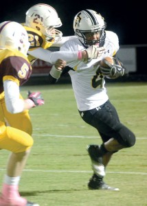 PULLING AWAY - Chris Gilmore breaks a Pirate tackle. Messenger photo by Mack Thweatt
