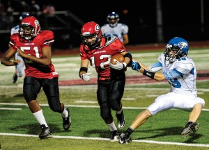 PULLING HARD - Decatur's Jared Durdon tries to take down a Gainesville runner during the Eagles' 42-21 loss Friday night. Messenger photo by Joe Duty