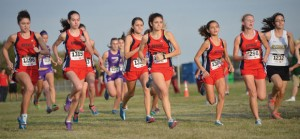 SETTING THE PACE - The Northwest Lady Texans get off to a good start  Thursday at the District 4-5A Cross Country Meet in Grapevine. Northwest finished second. Messenger photo by Joe Duty