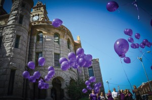 SIMPLE REMINDER - The Wise Hope Shelter and Crisis Center released purple balloons from the lawn of the county courthouse in Decatur Monday. The event marked the start of Domestic Violence Awareness Month. Messenger photo by Joe Duty