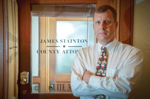 "STANDING HIS GROUND - County Attorney James Stainton stands in front of his office at the county courthouse this week. He said every prosecutor he knows has had threats made againt them, but this was a first for him. ""This isn't personal to me. It's business,"" he said. ""And if Pippin has to come before me again, I'll still treat him just like anyone else."" Messenger photo by Joe Duty"