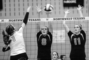 STILL ALIVE - Northwest's Kayla Knaust and Jessica Sanders go up for the block against Richland Tuesday. Messenger photo by Joe Duty