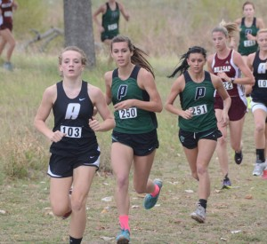STRONG FINISH - Alvord's Savannah Williams and Paradise's Bailey Sides and Ashley Sparks make their way to toward the finish line during the district cross-country meet Monday. Both teams advanced to the regional meet. Messenger photo by Mack Thweatt