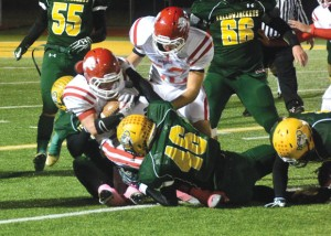 TAKEDOWN - Chase Graham and a host of Yellowjackets tackle a Ponder runner. Messenger photo by Mack Thweatt