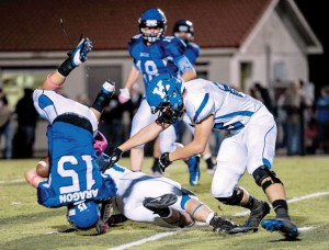 UPENDED - Decatur running back Hunter Aragon and the rest of the Eagles will be looking for a win against rival Bridgeport to keep their playoff hopes alive. Messenger photo by Joe Duty