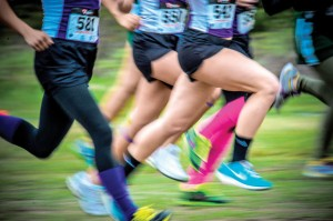 WHEN COLORS RUN - Cross country runners move along the trail in their brightly colored socks and shoes on a brisk Saturday morning at the Decatur Reunion Run. Messenger photo by Joe Duty