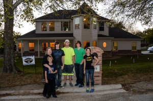 A PLACE TO CALL HOME - Laura Blaylock (second from left) and her five children - Cason, Lane, Brevon, Christian and Miranda - moved into their new home last week. Messenger photo by Joe Duty