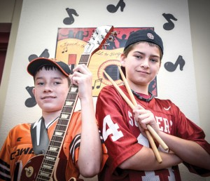 "BEDLAM UNITED - Chisholm Trail Middle School seventh graders Bo Faver (left) and Riley Adams will perform at the House of Blues Saturday in Dallas, the same day as the rivalry football game between Okahoma State University and the University of Oklahoma, after which the duo named their band, ""Bedlam United"" was derived from each family's opposing allegiances in the rivalry. Messenger photo by Joe Duty"