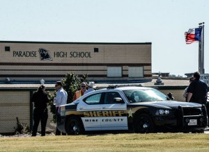 BOMB THREAT - Students at Paradise High School were evacuated late Friday morning after a bomb threat was found scrawled on the stall in a bathroom. Students returned to class a couple of hours later after a thorough search turned up no explosives and emergency responders cleared the scene. Messenger photo by Joe Duty