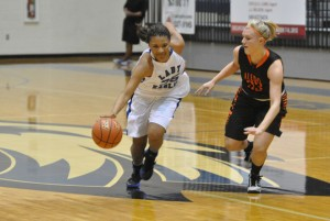 BREAKING AWAY - Decatur's Jasmyne Tate dribbles past an Aledo defender Tuesday. The Lady Eagles dropped their first game of the season, 53-39. Messenger photo by Clay Corbett