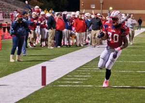 CROSSING THE LINE - Northwest's Emmanuel Moore runs in a touchdown in the Texans'  victory over the Falcons October 26. Messenger photo by Jimmy Alford