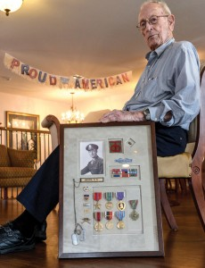 DECORATED HERO - Don Brown of Decatur keeps the medals, pins and badges he earned while serving in the U.S. Army during World War II in a shadow box on his wall. Messenger photo by Joe Duty