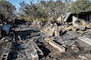 FATAL FIRE - A fire that destroyed a mobile home between Cottondale and Boyd early Sunday morning, killed the home's only occupant, Henry Crowson. When a neighbor discovered the fire just before 5 a.m., the home was fully involved. Messenger photo by Joe Duty