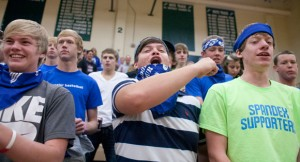 GO TEAM - Three Decatur fans show their support during the region final. Messenger photo by Jimmy Alford