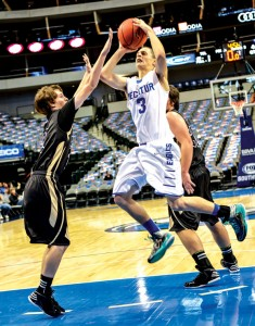 GOING UP - Cameron Mize attempts two points with one Raider on his heels and another in his face. Decatur went on to win over Wichita Falls Rider. Messenger photo by Joe Duty