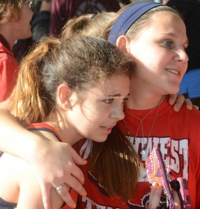 GOOD FINISH - Katherine Chavez gets some help after the race Saturday. Messenger photo by Mack Thweatt