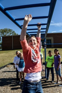 HANGING OUT - Justina Ravenstein reaches for the next rung on the monkey bars at Rann Elementary while playing with friends (from left) Meaghan Thompson, Carmela Liles, Jakeline Munoz and Yarely Paiz. The fifth-grader was diagnosed with type I diabetes in August but hasn't let it slow her down.