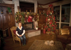 HOME FOR THE HOLIDAYS - Candy Burden and the family dog, Max, prepare to welcome Tour of Home guests. Messenger photo by Joe Duty