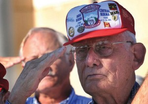 HONNORED - W.B. Woodruff salutes Sept. 15 during the national anthem at the dedication of a memorial stone for the World War II mule packers at the Airborne & Special Operations Museum in downtown Fayetteville. Photo courtesy of Cindy Burnham/Fayetteville Observer