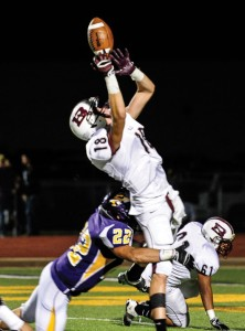 LEAPING CATCH - Bridgeport's Alex Kline soars to snag a pass from Trey Cook during the Bulls' 47-24 win Friday night. Messenger photo by Joe Duty