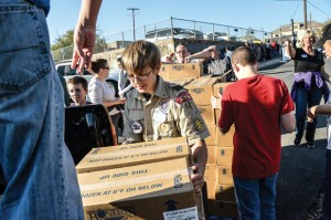 LENDING A HAND - Boy Scout Tommy Tilson, 13, of Boyd helps unload 500 pumpkin pies at the Wise Area Relief Mission Tuesday morning. Messenger photo by Joe Duty
